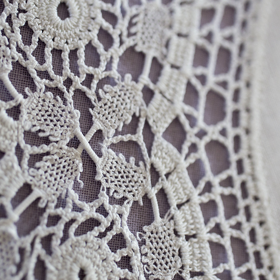 Crochet doily in unusual technique - detail from integrated ribbon