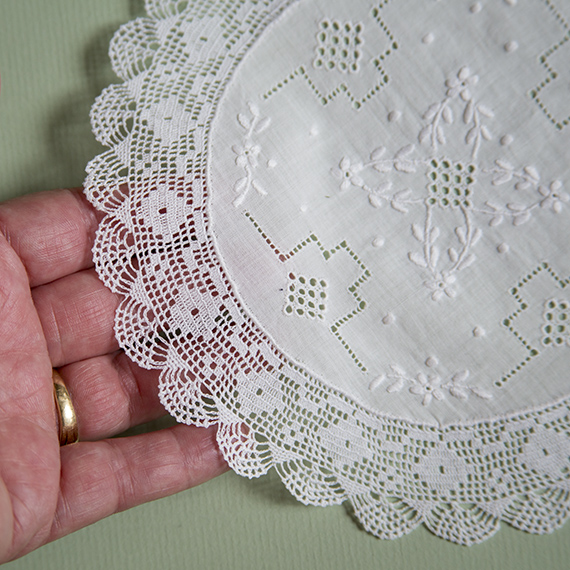 Crochet doily with embroidered center piece